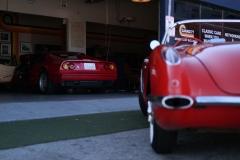 Garage-77-Ferrari-328-Corvette-C1-infront-of-garage