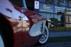 Garage-77-sign-on-the-garage-door-Corvette-in-front-
