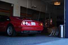 Red-Ferrari-328-behind-in-garage-
