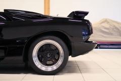 Lamborghini-Diablo-Black-Half-Behind-Garage