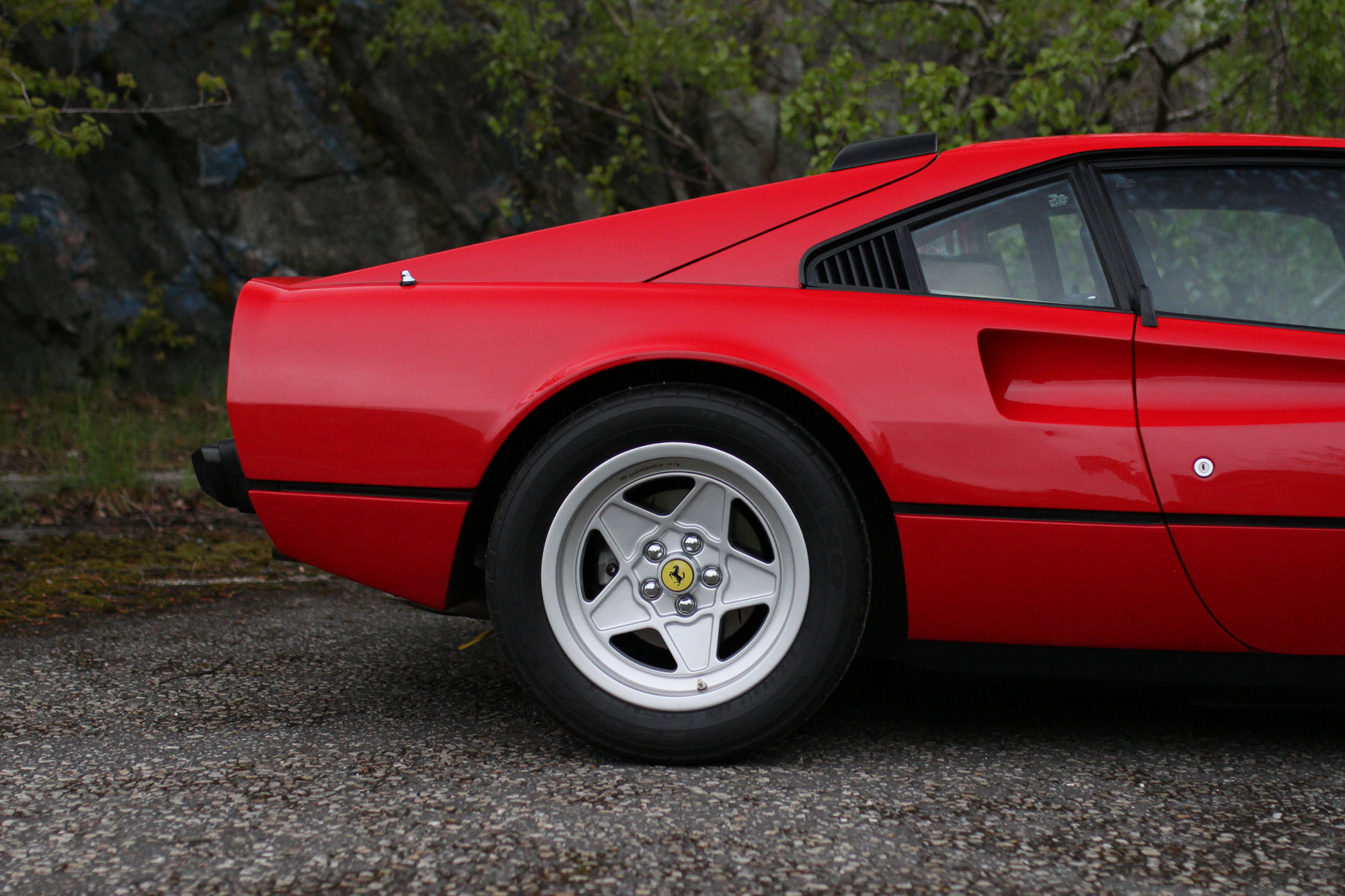 The right behind of the red Ferrari 308